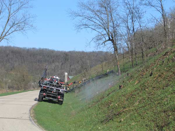 Spraying the road cut of Pleasant Valley Road